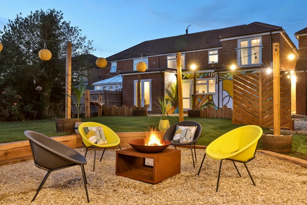 B-Hive Living outdoor social area with a firepit