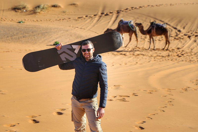 Andrea sandboarding in the desert