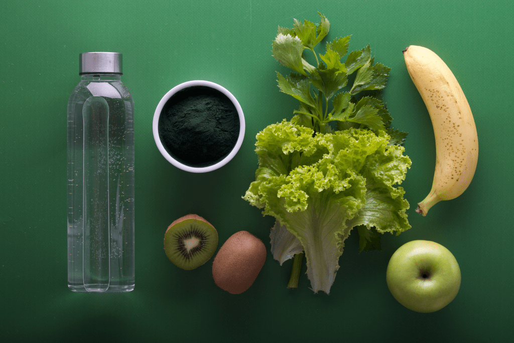Bottle of water and healthy fruit and vegetables