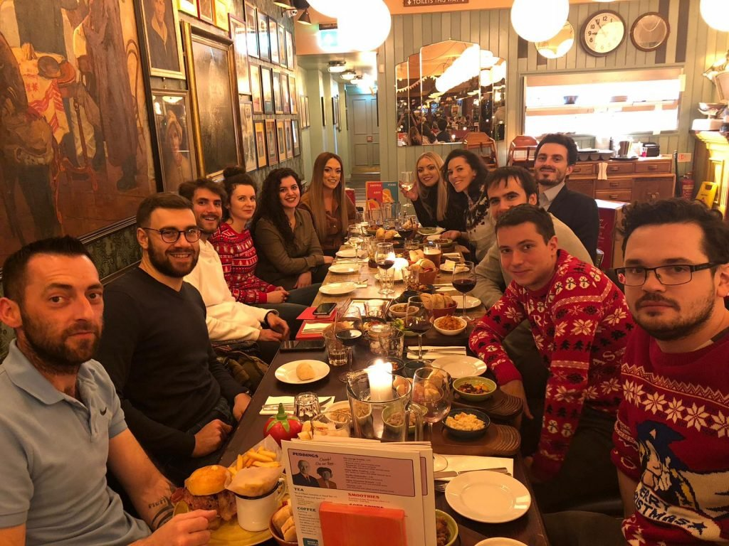 a group of people at a christmas table